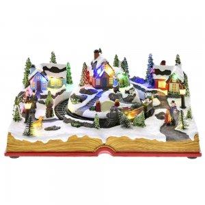 Χριστουγεννιάτικο διακοσμητικό χωριό με τρενάκι πάνω σε βιβλίο με κίνηση και φως 28x21x12 εκ